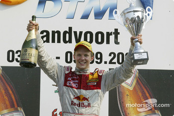Podium: race winner Mattias Ekström celebrates