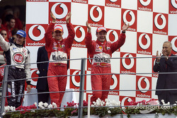 Podium: race winner Rubens Barrichello with Michael Schumacher and Jenson Button