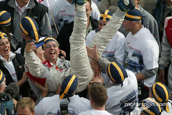 Race winner and DTM 2004 champion Mattias Ekström celebrates with his team