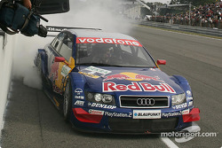Race winner and DTM 2004 champion Mattias Ekström at finish line
