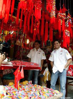Giancarlo Fisichella and Felipe Massa visit a Chinese market