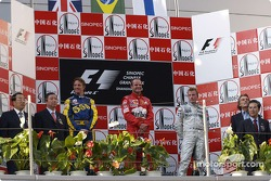 Podium: race winner Rubens Barrichello with Jenson Button and Kimi Raikkonen