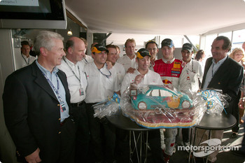 Audi AG board member Ralph Weyler honours the winning Audi team
