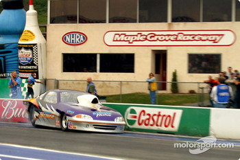 David Strouse hits the wall during his burnout in Pro Stock