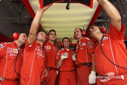 Ferrari team members watch Michael Schumacher qualifying lap