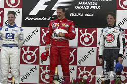 Podium: race winner Michael Schumacher with Ralf Schumacher and Jenson Button
