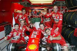 Ferrari team members celebrate yet another victory