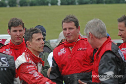 Scott Pruett congratulates the winning team