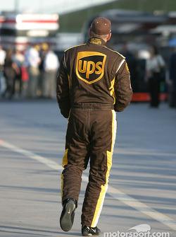 Dale Jarrett walks back to his team transporter after practice