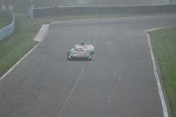 Archie Urciuoli Lola T-70 Spyder. and Doc Bundy Lotus 23B  as the fog cree