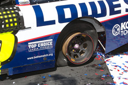 Victory lane: Jimmie Johnson's left rear tire was destroyed from doing burns outs and doughnuts around the track