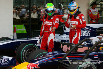 Felipe Massa, Scuderia Ferrari and Fernando Alonso, Scuderia Ferrari looking at the Red Bull