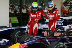 Felipe Massa, Scuderia Ferrari and Fernando Alonso, Scuderia Ferrari looking at the Red Bull