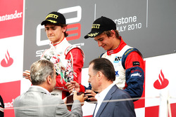 Nico Muller celebrates on the podium with Esteban Gutierrez
