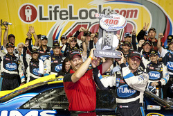 Victory lane: race winner David Reutimann, Michael Waltrip Racing Toyota celebrates