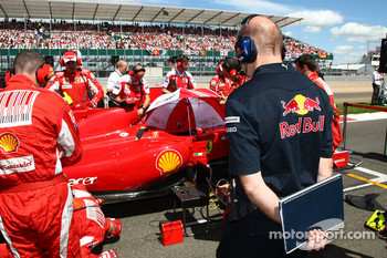 Adrian Newey, Red Bull Racing, Technical Operations Director looks at the Ferrari
