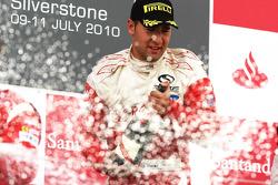 Daniel Morad celebrates victory on the podium