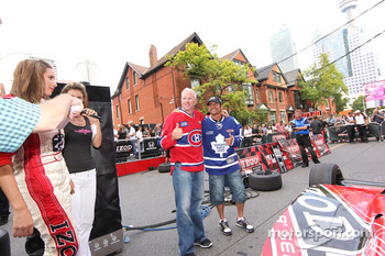 Party on John Street: Alex Tagliani, FAZZT Race Team and Paul Tracy, KV Racing Technology trade hockey jersey