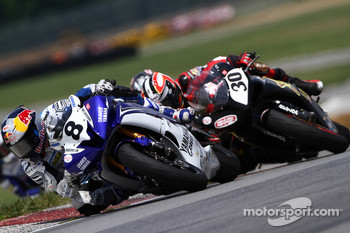 Josh Herrin works to fend off a charging Bobby Fong
