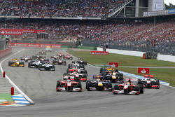 Felipe Massa, Scuderia Ferrari leads Fernando Alonso, Scuderia Ferrari and Sebastian Vettel, Red Bull Racing at the start