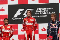 Podium: race winner Fernando Alonso, Scuderia Ferrari, second place Felipe Massa, Scuderia Ferrari, third place Sebastian Vettel, Red Bull Racing