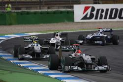 Michael Schumacher, Mercedes GP leads Nico Rosberg, Mercedes GP