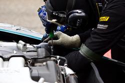 #64 Brussels Racing Aston Martin DBRS9 GT3: Eddy Renard, Tim Verbergt, Koen Wauters, Jeff Van Hooydonk mechanics work on their car
