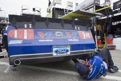 A crew member for the No. 60 Valvoline Ford team makes adjustments