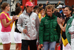 Jenson Button, McLaren Mercedes and Jarno Trulli, Lotus F1 Team