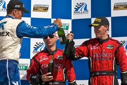DP podium: Scott Pruett, Jon Fogarty and Alex Gurney, Max Angelelli celebrate with champagne