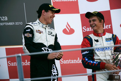 Robert Wickens celebrates victory on the podium with Nico Muller