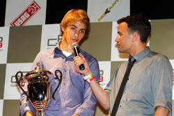 Nico Muller receives his prize for 3rd over all in the championship