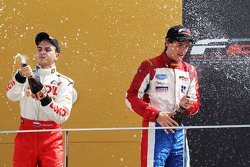Sergey Afanasiev celebrates his third place in the championship with Jolyon Palmer