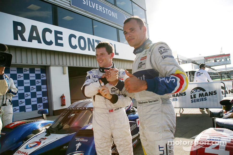 Race winner Anthony Davidson celebrates with Stphane Sarrazin