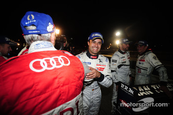 Race winner Pedro Lamy is congratulated by the Audi team