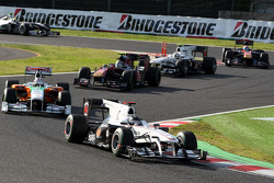 Nico Hulkenberg, Williams F1 Team, leads Adrian Sutil, Force India F1 Team