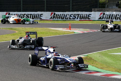 Rubens Barrichello, Williams F1 Team leads Michael Schumacher, Mercedes GP