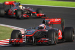 Jenson Button, McLaren Mercedes leads Lewis Hamilton, McLaren Mercedes