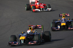 Sebastian Vettel, Red Bull Racing leads Mark Webber, Red Bull Racing and Fernando Alonso, Scuderia Ferrari