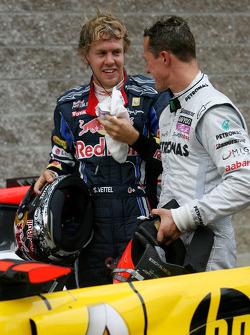 Pole winner Sebastian Vettel, Red Bull Racing and Michael Schumacher, Mercedes GP