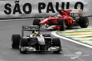 Nico Rosberg, Mercedes GP leads Fernando Alonso, Scuderia Ferrari