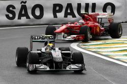 Nico Rosberg, Mercedes GP leads Fernando Alonso, Scuderia Ferrari