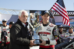 NASCAR Nationwide Series 2010 champion Brad Keselowski celebrates with Roger Penske