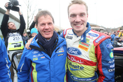 Jari-Matti Latvala and Malcolm Wilson celebrate as the Finn claims 2nd place overall in the 2010 WRC