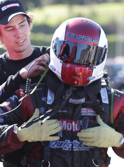 Bob Tasca removing his saftey equipment after defeating Matt Hagan  in Round 1 of the Auto Club NHRA Finals