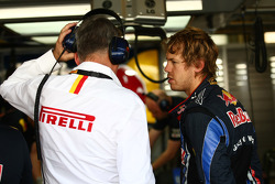 Pirelli staff with Sebastian Vettel, Red Bull Racing