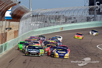 Restart: Carl Edwards, Roush Fenway Racing Ford and Martin Truex Jr., Michael Waltrip Racing Toyota lead the field