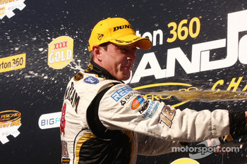 James Courtney celebrates after taking an emotional victory for Dick Johnson Racing