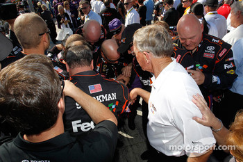 Joe Gibbs Racing Toyota team members confer