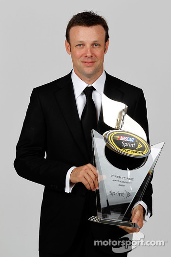 NASCAR driver Matt Kenseth poses with his fifth place trophy